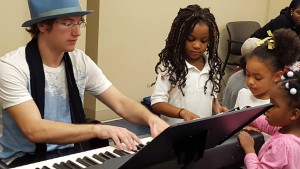Teddy Abrams at the Family Scholar House Holiday Party. Photo courtesy Louisville Orchestra.